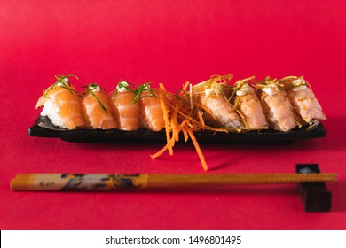 Sushi dishes in a red color background