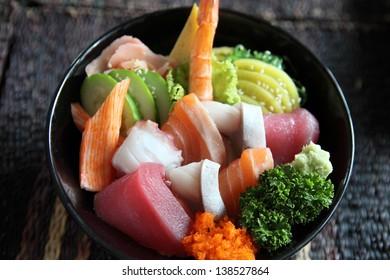 Sushi don , raw salmon tuna octopus on rice