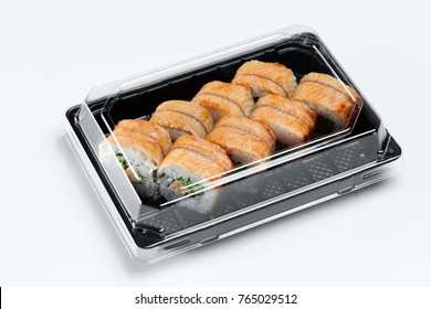 Sushi with eel in plastic box take away container isolated on white. Sushi delivery in plastic container