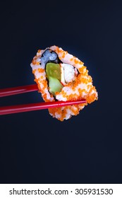 sushi with fish caviar studio shot with black background