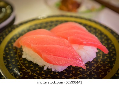 Sushi fish twin with wasabi on disk plate in restaurant.