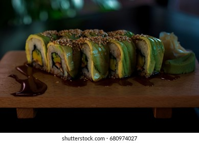 Sushi green dragon on a wood tile
