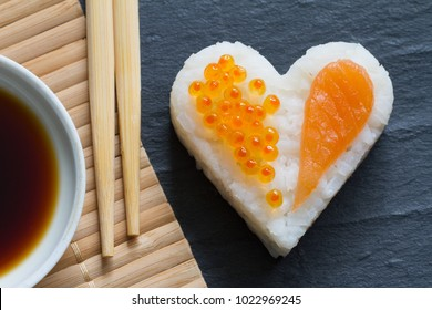 Sushi heart macro seafood concept with salmon and caviar