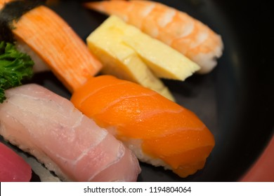 Sushi is a Japanese dish of specially prepared vinegared rice, usually with some sugar and salt, combined with a variety of ingredients, such as seafood, vegetables, and occasionally tropical fruits