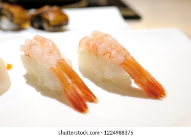 Sushi is a Japanese dish of specially prepared vinegar rice, usually with some sugar and salt, combined with a variety of ingredients, such as seafood, vegetables, and occasionally tropical fruits.