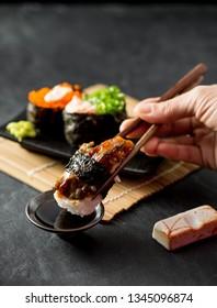 Sushi Japanese eel on black table background