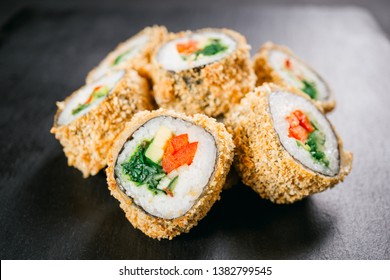 sushi, japanese food, deluxe restaurant menu, delicious traditional seafood. philadelphia and vegetarian tempura sushi rolls, served on black plate