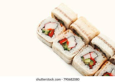 Sushi japanese restaurant delivery. Set of unagi eel rolls isolated on white background closeup, copy space. Healthy seafood, cutout for menu