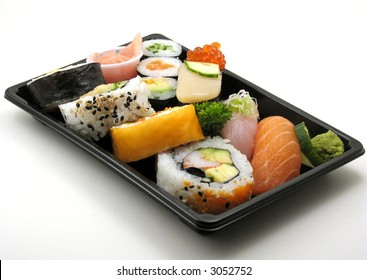 Sushi lunch with salmon, scallop and more in a box for takeout, on white.
