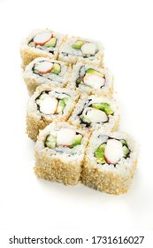 Sushi maki rolls with sesame seeds around them and various ingredients, salmon, shrimp, prawns, eel, white rice, cooked salmon, cucumber, philadelphia cheese and other