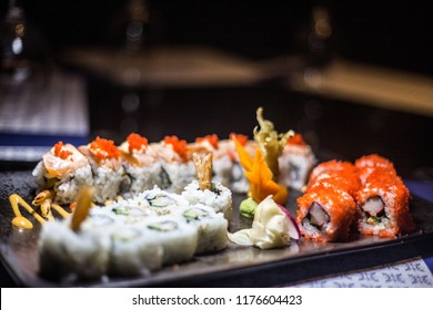 sushi maki rolls set in a variety of japanese food
