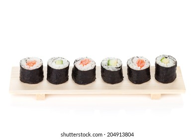 Sushi maki with salmon and cucumber. Isolated on white background