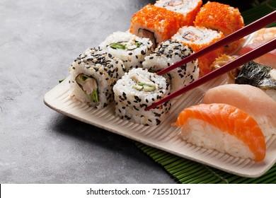 Sushi and maki set on stone table