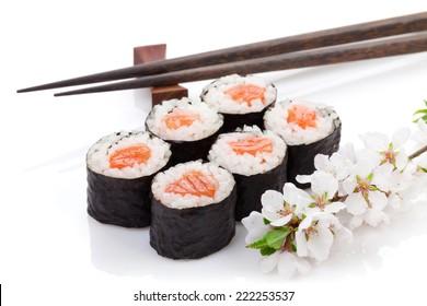 Sushi maki set and sakura branch. Isolated on white background