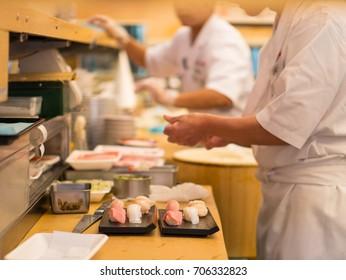 Sushi master preparing sushi in Tokyo.
