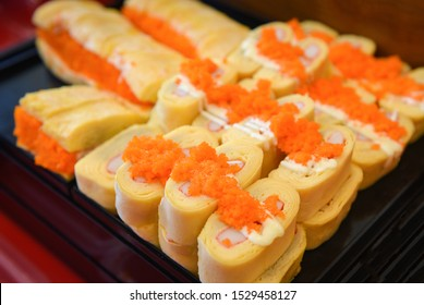 Sushi menu set Japanese cuisine fresh ingredients on tray / Japanese food sushi roll rice crab stick omelet with Tobiko egg is orange (flying fish roe) in the restaurant