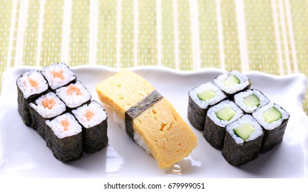 sushi mix with hosomaki and tamago nigiri