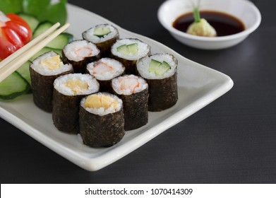 Sushi multiple stuffed Japanese food  on white dish with wasabi sauce / Selective focus