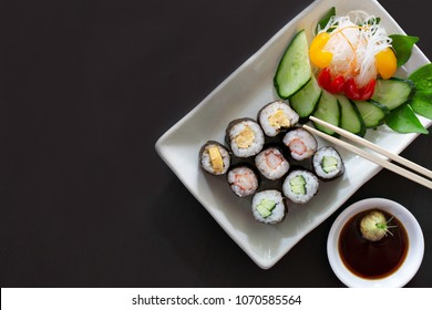 Sushi multiple stuffed Japanese food  on white dish with wasabi sauce / Selective focus and space for message