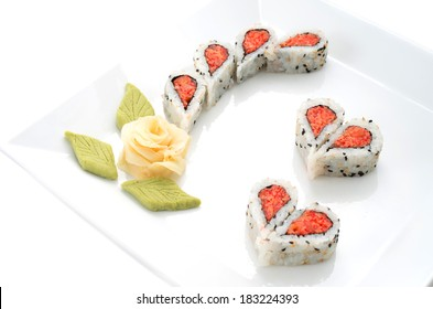 Sushi nicely decorated forming hearts  shapes on white square dish