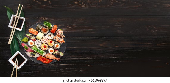 sushi on a black wooden surface