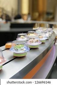 Sushi on conveyor belt in Japanese restaurant
