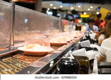 Sushi on conveyor belt or kuru kuru sushi or kaiten sushi in Jap