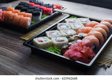 the sushi on the table in the delivery package, ordered in sushi roll