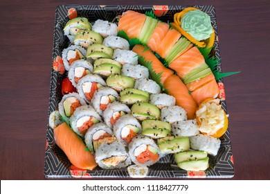 Sushi Party Platter with fresh raw smoked salmon California Caterpillar rolls Nigiri Wasabi ginger