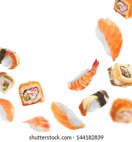 Sushi pieces flying on white background