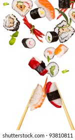 Sushi pieces with sticks flying on white background