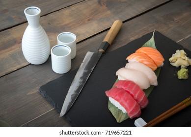 sushi platter with sashimi knife