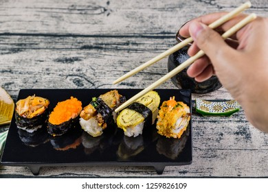 Sushi, Popular Japanese Cuisine. Made from rice mix with vinegar, Mold and put on or stuff the meat and vegetables, Eat with wasabi and Japanese sauce.