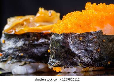 Sushi, Popular Japanese Cuisine. Made from rice mix with vinegar, Mold and put on or stuff the meat and vegetables, Eat with wasabi and Japanese sauce. (Close up)