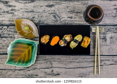 Sushi, Popular Japanese Cuisine. Made from rice mix with vinegar, Mold and put on or stuff the meat and vegetables, Eat with wasabi and Japanese sauce. (Top view)