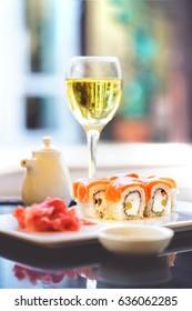 Sushi, a portion of Philadelphia sushi,philadelphia sushi tumblr,philadelphia roll. Ginger and a glass of wine. Japanese kitchen,Japanese cuisine,Japanese food. Japanese restaurant