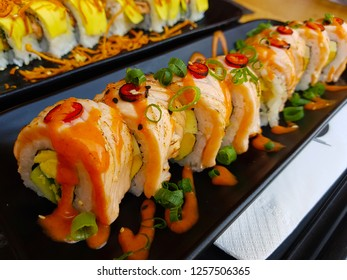 Sushi roll with chilli, smoked salmon and vegetables