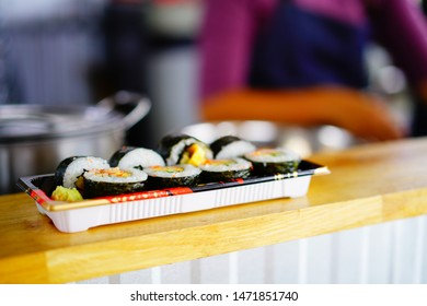 Sushi roll isolated on black background. Sushi japanese food in restaurant. Piece of California Sushi roll set with salmon, vegetables, flying fish roe and caviar closeup IN THAILAND.