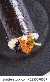 Sushi roll - japanese food on a black plate isolated on white background