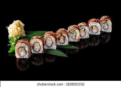 Sushi roll (Maguro) with shrimp, smoked eel, avocado, philadelphia cheese on black background. Sushi menu. Japanese food.