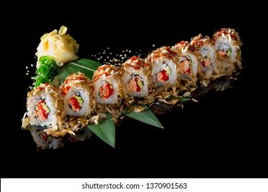 Sushi roll (Maguro) with tuna, shrimp, salmon, smoked eel, avocado, philadelphia cheese on black background. Sushi menu. Japanese food.