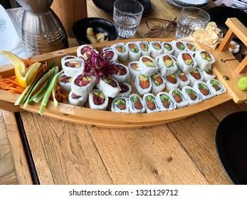 Sushi roll with prawn, avocado, tuna, salmon fish. Sushi menu. Japanese food.