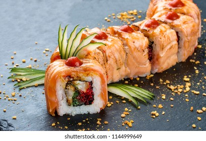 Sushi roll Red Dragon on black background