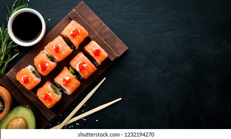 Sushi roll with salmon, mussels and caviar. Japanese cuisine. Top view.