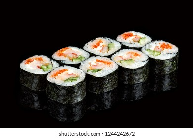 Sushi roll with scallops and caviar on a black background, isolated