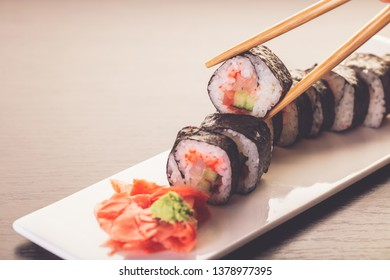 sushi roll set in a plate on wooden background