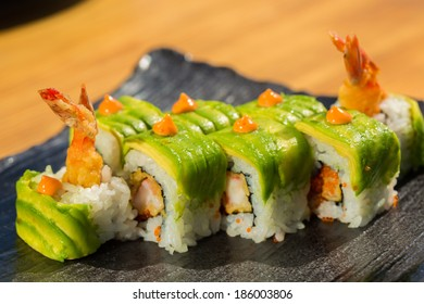 sushi roll with  shrimp tempura at restaurant