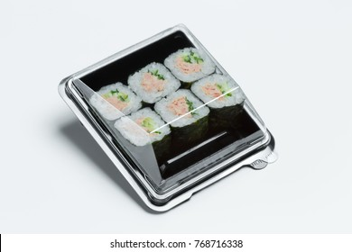 Sushi roll with tuna in a plastic container. Take away sushi roll in a plastic box isolated on white
