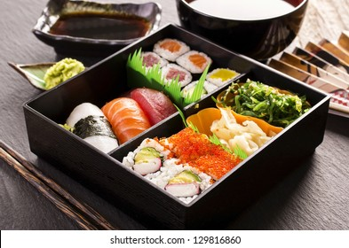 sushi and rolls in bento box