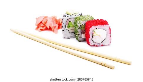 Sushi rolls with chopsticks isolated on white background